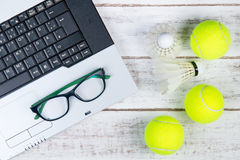 Top view of laptop, Sports Equipment, Tennis ball, Shuttlecock a Royalty Free Stock Image