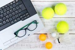 Top view of laptop, Sports Equipment, Tennis ball, Shuttlecock a Royalty Free Stock Photos