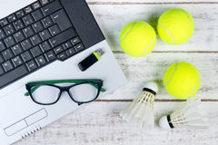 Top view of laptop, Sports Equipment, Tennis ball, Shuttlecock, Royalty Free Stock Photo