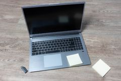 Top view of a laptop on a wooden table. With usb stick and paper royalty free stock photo