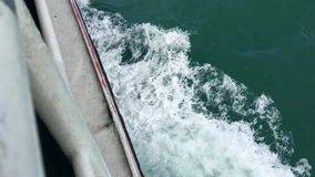 Top view from large ferry in the sea. Ship makes the water into beautiful waves and wakes. Slowmotion video background stock video