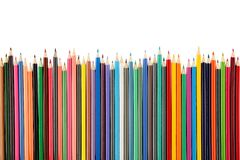 Top view of a large group of crayon pencils in vibrant colors, isolated on white background royalty free stock image