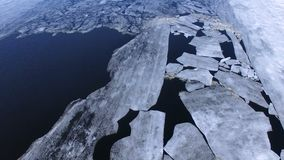 Large ice slabs floating in the middle of the river. stock footage