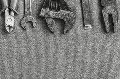 Top view layout of different tools as hammer, screwdriver, spanner and pliers on textile background royalty free stock photos