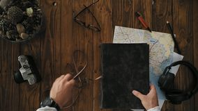 Mans hands open handmade a4 notebook with real leather cover stock video footage