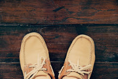 Top view leather shoes on wood floor - Vintage style Stock Photography