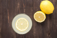 Top view lemonade with fresh lemon on wooden background Stock Photography