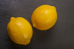 Top view of lemons on dark background. Stock Images