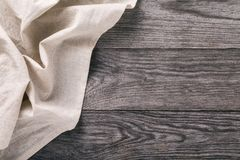 Top view of the light tablecloth on left side of wooden table. Food Background stock photography