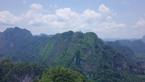 Aerial view of limestone rocks covered with lush tropical greenery. Top View of Mountains in Krabi and Suratthani. Top view of limestone rocks in tropical stock footage