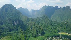 Aerial View of Limestone Rocks Covered with Lush Tropical Greenery. Top View of Mountains in Krabi and Suratthani. Top View of Limestone Rocks in Tropical stock video footage