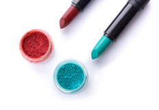 Top view of lipsticks with matching eye shadows Stock Image