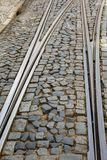 Lisbon high slope street with rail fork Royalty Free Stock Photos