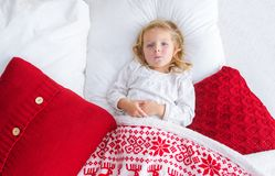 Top view of a little beautiful girl laying on her bed royalty free stock photography