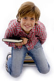 Top view of little boy holding book Royalty Free Stock Image
