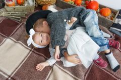 Top view of little brother and sister lying on carpet. royalty free stock photos