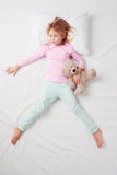 Top view of little girl sleeping in Freefaller Stock Photo