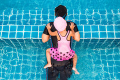 Top view of little girl swimming with mother Stock Photography