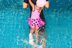 Top view of little girl swimming with mother Royalty Free Stock Image