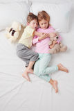 Top view of little sleeping brother and sister Royalty Free Stock Photos