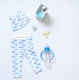 Top view look of baby clothes and toy stuff Stock Photo