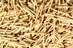 Top view of a lot of wooden matches macro or close up with black Stock Photography