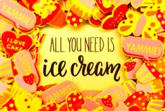Lots of colourful foam stickers depicting hearts, butterflies and cupcakes or ice cream. Summer or joy concept stock photo