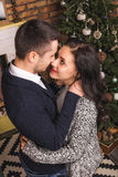 Top view love couple hugging Christmas fireplace Royalty Free Stock Images