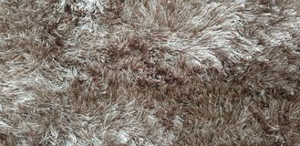 Top view of a luxurious grey fur rug. Top view luxurious fur rug gre grey interior homefurnishing mat luxury stock photo