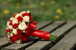 Top view of luxury bouquet of red and white flowers on pallet. top view with red bow on wedding day holiday stock images