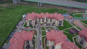 Top view of luxury suburban apartment complex. Clip. Aerial view apartment buildings complex and residential houses. Neighborhood stock video footage