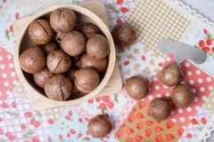 Top view macadamia on napery and wooden bowl Stock Image