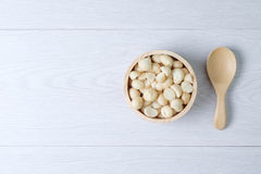 Top view macadamia nuts and shell in wooden bowl Stock Photos
