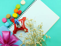 Top view of macaroons and souvenir eiffel tower with diary copy space background Stock Image