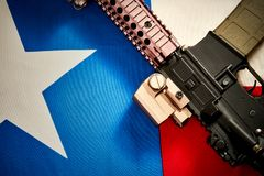 Top view of a machine gun located on the background of the texas flag. Top view of a machine gun that is located on the background of the texas flag royalty free stock photos