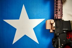 Top view of a machine gun located on the background of the texas flag. Top view of a machine gun that is located on the background of the texas flag stock photos