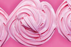 Pink frosting on cupcake Stock Images