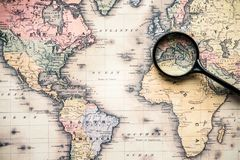Top view of magnifying glass on vintage map over. Mediterranean sea stock image