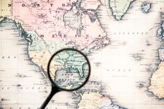 Top view of magnifying glass on world map over. Gulf mexico stock image