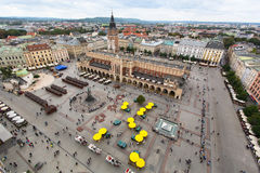 Top view of the Main Square of Krakow and the cloth hall and monument to Adam Mickiewicz Royalty Free Stock Photo
