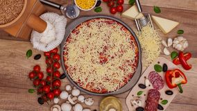Top view of making a pizza with ingredients appearing - stop motion animation stock footage