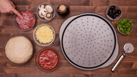 Top view of making a pizza with the tap of a finger stock footage
