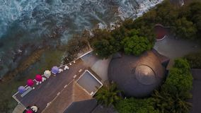 Top view of Maldives island, camera is rising over the bar at luxury tropical hotel resort. Drone ascending over the stock video footage