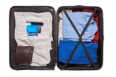 Preparation for travel. Top view of male clothes and accessories for travel in valise Stock Photography