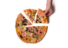 Top view of male hand picking delicious Italian pizza slice Royalty Free Stock Images