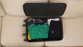 Top view of male hands packing clothes and preparing a suitcase for travel. Top view of male hands packing clothes and preparing suitcase for travel stock video
