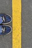 Top View of Male shoes on the asphalt road with yellow line, Ste. Top View of Male shoes on the asphalt road with yellow line. Step into Royalty Free Stock Images