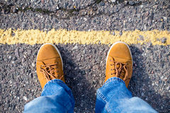 Top view of male sneakers on the asphalt road Royalty Free Stock Photo