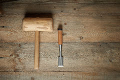 Top view, mallet and chisel on wooden workbench. Top view, mallet and chisel on a wooden workbench Stock Photo