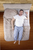 Top View of Man On Bed Royalty Free Stock Photography